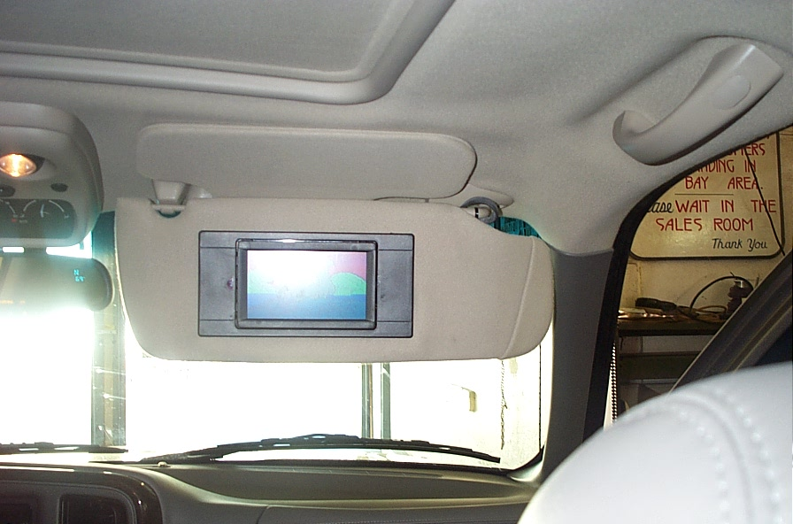 Here is an 03' Yukon Denali with a monitor in the front passengers ...